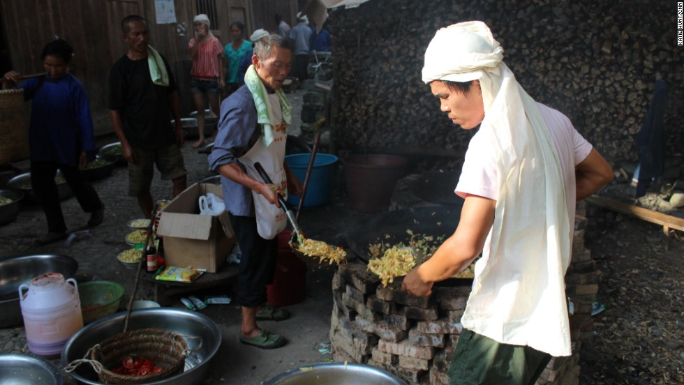 The village marks major events like births and deaths with communal meals cooked in giant woks.