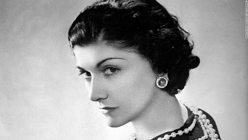 Coco Chanel was born as Gabrielle Bonheur Chanel on August 19, 1883, in Saumur, France. One hundred and thirty years later, the famed French couturier's legacy continues to shine. Here, Chanel strikes a coy smile in Paris in 1936. Click through the gallery to learn all about her iconic fragrance: Chanel No. 5.