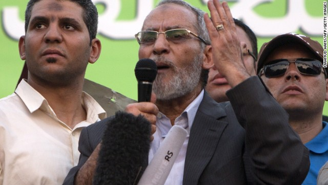 File: Mohammed Badie, center, leader of Egypt's Muslim Brotherhood, addresses supporters in Cairo in July 2013. An Egyptian court upheld the death sentences against Badie and 182 of the Brotherhood's supporters on Saturday.