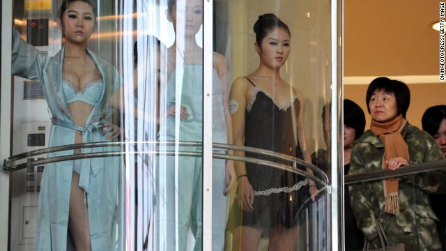 Models pose during a lingerie show on International Women's Day at a shopping mall in 2011 in Qingdao, Shandong.