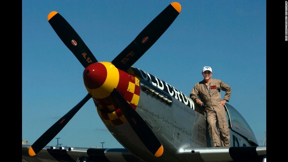 Jim Hagedorn, CEO of Scotts Miracle-Gro, poses in 2007, with his P-51 Mustang airplane.