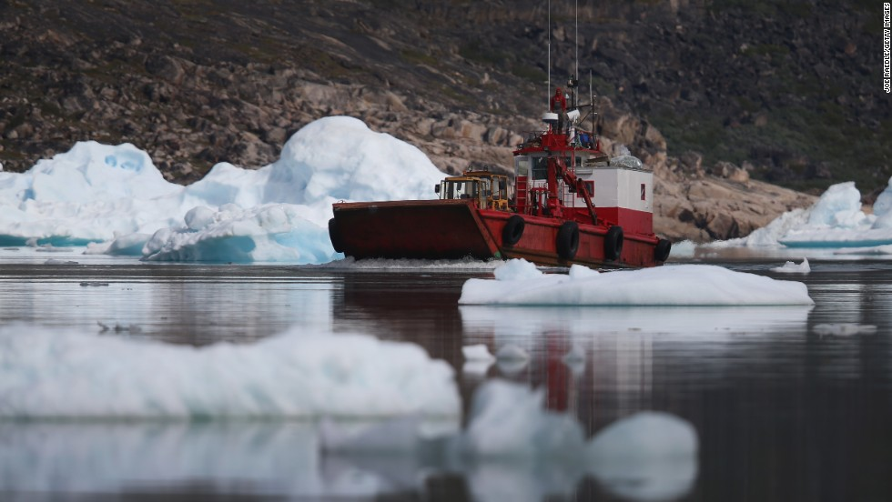 A boat navigates among calved icebergs from the nearby Twin Glacier on July 31 near Qaqortoq. Boats are a crucial mode of transportation in a country that has few roads.