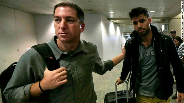 Journalist Glenn Greenwald  walks with his partner David Miranda in Rio de Janeiro's International Airport on August 19.