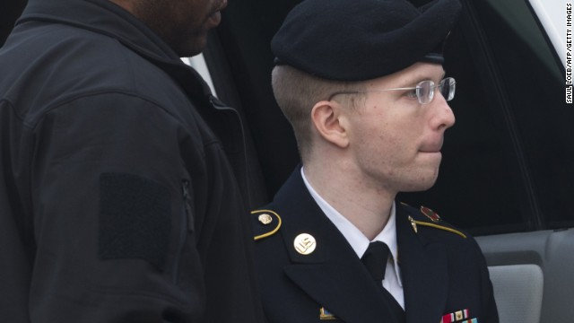 US Army Private First Class Bradley Manning arrives alongside military officials at a US military court facility to hear his sentence in his trial at Fort Meade, Maryland on August 21, 2013. A sentencing decision will be announced later Wednesday. AFP PHOTO / Saul LOEBSAUL LOEB/AFP/Getty Images