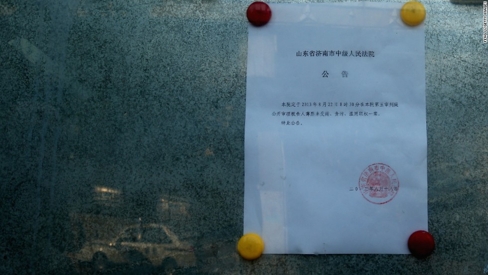 A notice about Bo Xilai's trial is posted outside the courthouse on August 21.