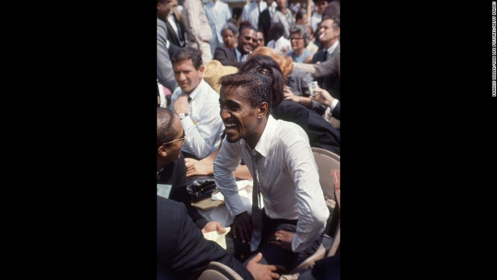 African-American entertainer Sammy Davis Jr. attends the rally.