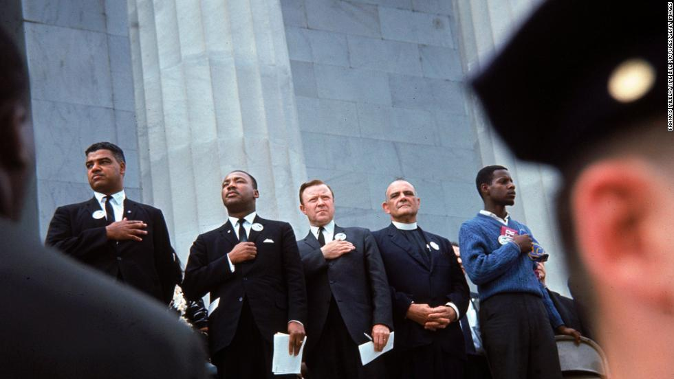 Civil rights leaders from left, Whitney Young Jr., Martin Luther King Jr., Walter Reuther, Eugene Carson Blake, and John Lewis stand on the steps of the Lincoln Memorial during the march.