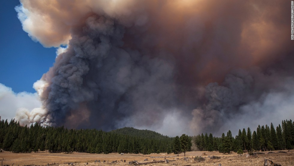 Giant plumes of smoke rise up from the Rim Fire near the border of Yosemite National Park on August 23.