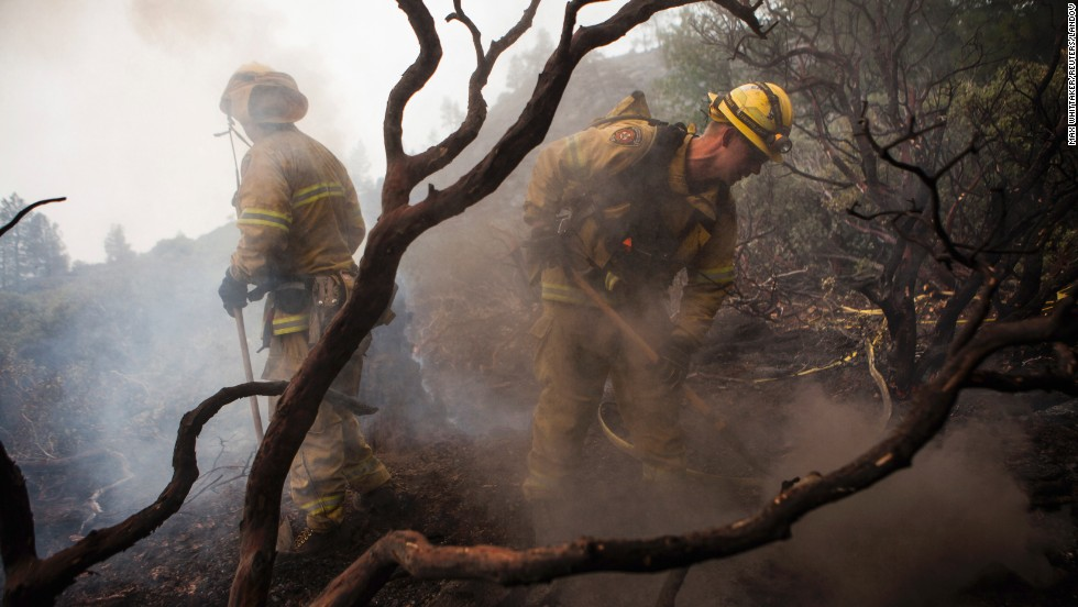 El Dorado Hills firefighters work to douse a hotspot in Yosemite National Park on August 24. Nearly 5,000 firefighters are attempting to bring the fast-moving fire under control.