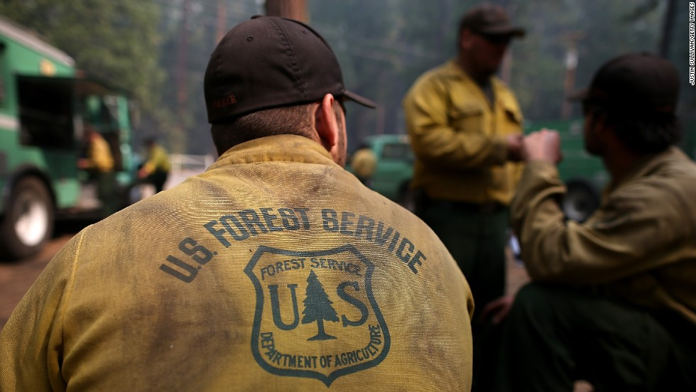 U.S. Forest Service firefighters take a break from battling the Rim Fire at Camp Mather on August 25.
