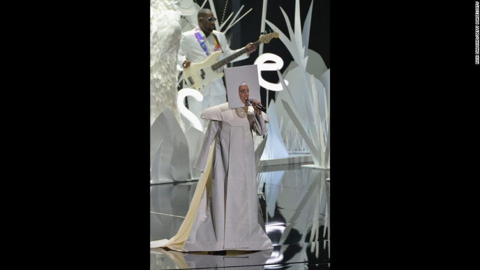 "Lady Gaga returned to the VMAs stage for the first time in two years. She opened the show with her new single ""Applause,"" featuring the singer's requisite multiple costume and hair changes, starting with this conceptual get-up ..."