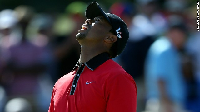 Tiger Woods reacts after missing a putt on the 12th hole during the final round of The Barclays at Liberty National Golf Club.