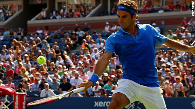 Roger Federer plays from the baseline during his comfortable first round victory at the U.S. Open.