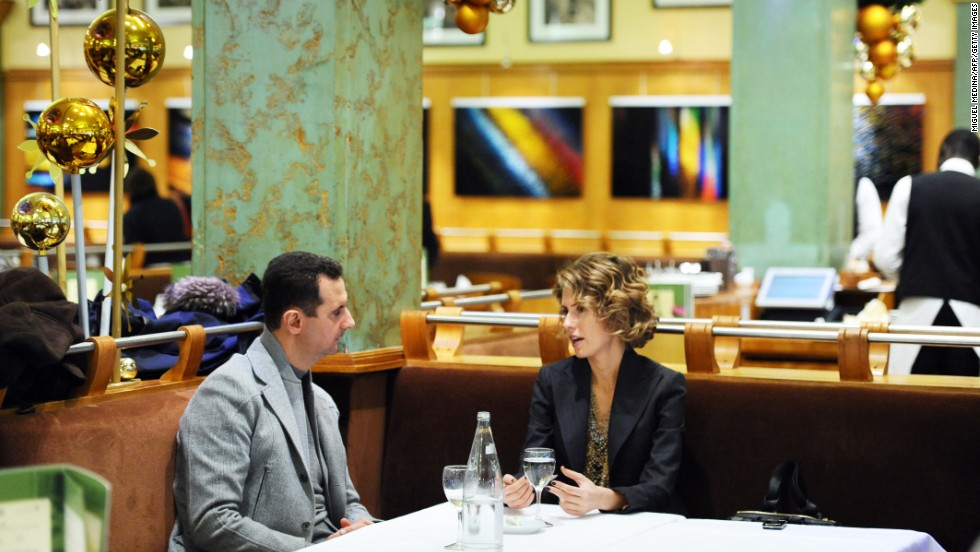 Asma al-Assad, right, and husband Bashar sit at the Coupole restaurant in Paris on December 10, 2010.