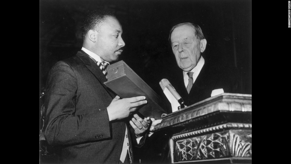 King receives the Nobel Prize for Peace from the president of the Nobel Prize committee, Gunnar Jahn, in Oslo, Norway, on December 10, 1964. At the time he was the youngest person to win the prize.