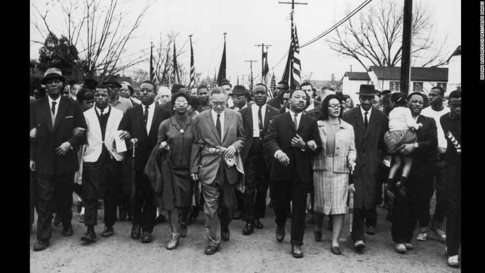 King and his wife lead a black voting rights march from Selma to Montgomery, Alabama, on March 30, 1965.