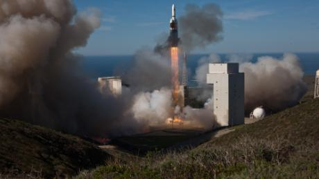 The National Reconnaissance Office oversees American spy satellites like this one launched in 2011. Last week, the FBI raided the home of a former contractor there.