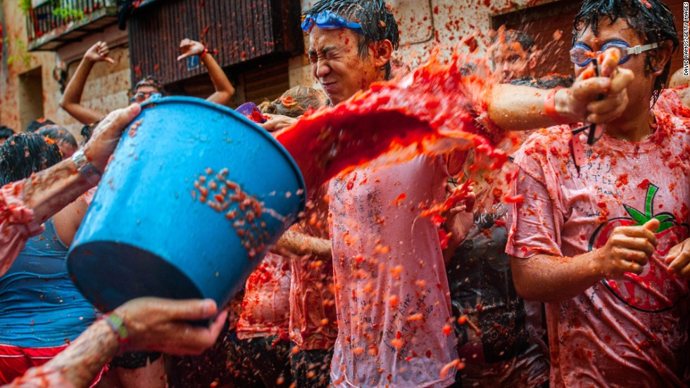 There aren't many rules to La Tomatina -- it seems to epitomize anarchy -- but it can only start when someone from the crowd manages to climb up a a greased pole and dislodge a large ham placed there for the event. A cannon then fires and the fruit frenzy begins.