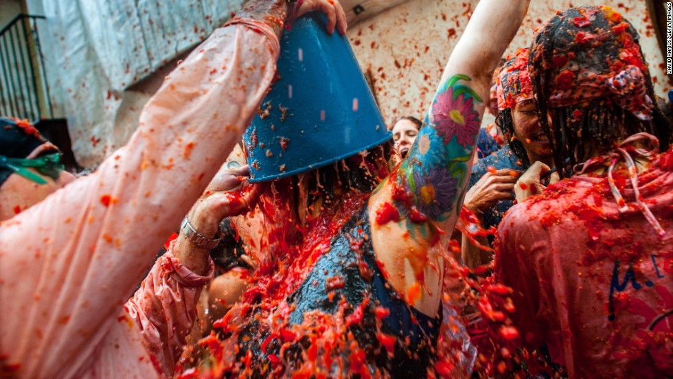 For the first time this year, La Tomatina participants were charged -- 10 euros ($13) -- to be drenched in pulped fruit juice. Organizers also tried to halve the number of people taking part this year, concerned that the size of the crowds posed a safety risk.