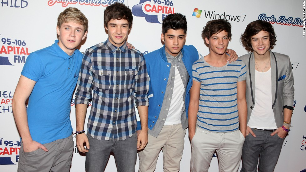 Which One Direction member recently purchased a house for his family?