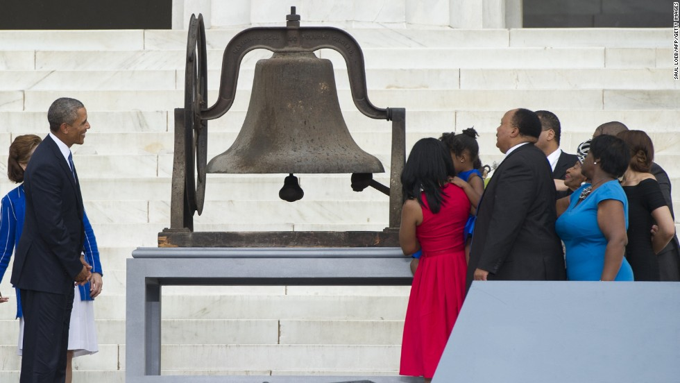 Members of the Rev. Martin Luther King, Jr's family ring a bell on Wednesday, August 28, as President Barack Obama watches, during the Let Freedom Ring Commemoration and Call to Action to commemorate the 50th anniversary of the March on Washington for Jobs and Freedom at the Lincoln Memorial in Washington.
