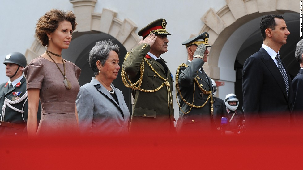 Asma al-Assad, left, appears with her husband and   Austrian President Heinz Fischer and his wife, Margit, during a welcoming ceremonies on April 27, 2009,  durring a two-day state visit to Vienna.