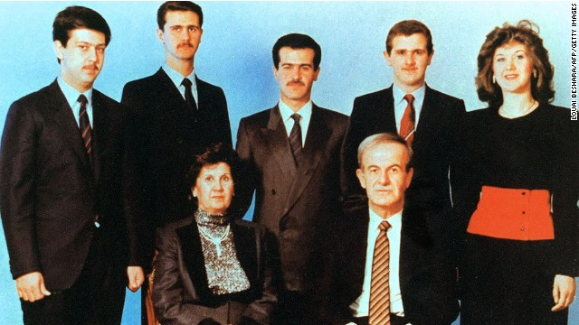 An undated  photo show's current Syrian President, second left, posing with his family.  Al-Assads parents, then-President Hafez al-Assad and his wife Anisseh, along with his siblings in the second row; Maher, Bassel, Majd and Bushra.