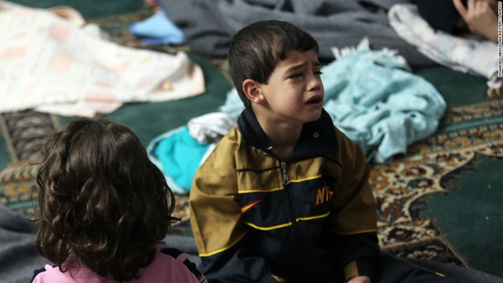 A young survivor takes shelter in a mosque in the Duma neighborhood of Damascus on August 21.