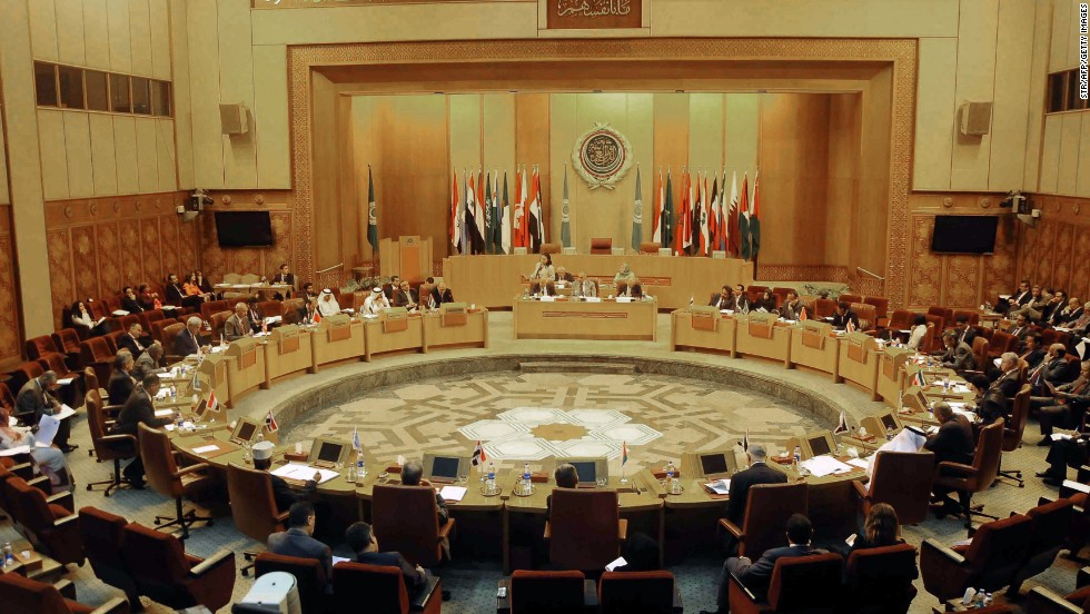 "Representatives of Arab countries discuss Syria at the Arab League headquarters in Cairo, Egypt, on Tuesday, August 27. President al-Assad vowed to defend his country against any outside attack. ""The threats of launching an aggression against Syria will increase its commitments,"" and ""Syria will defend itself against any aggression,"" he said, according to Syrian state TV."