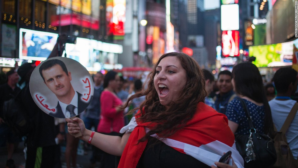 A Syrian-American supporter of Syrian President Bashar al-Assad participates in an anti-war rally in New York's Times Square on August 29.