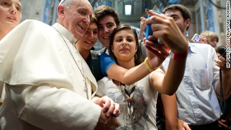 Pope Francis poses for a selfie with 500 youths from the diocese.