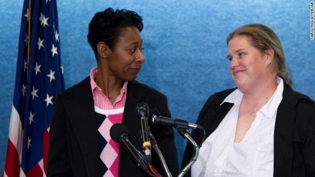 Tracey Cooper-Harris, who served in the Army for 12 years, left, and  her spouse, Maggie Cooper-Harris speak during a news conference in Washington, Feb. 1, 2012.