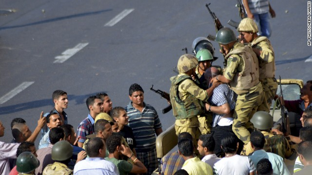 Egyptian soldiers detain a man during clashes in the streets of Alexandria, Egypt, on August 30, 2013.