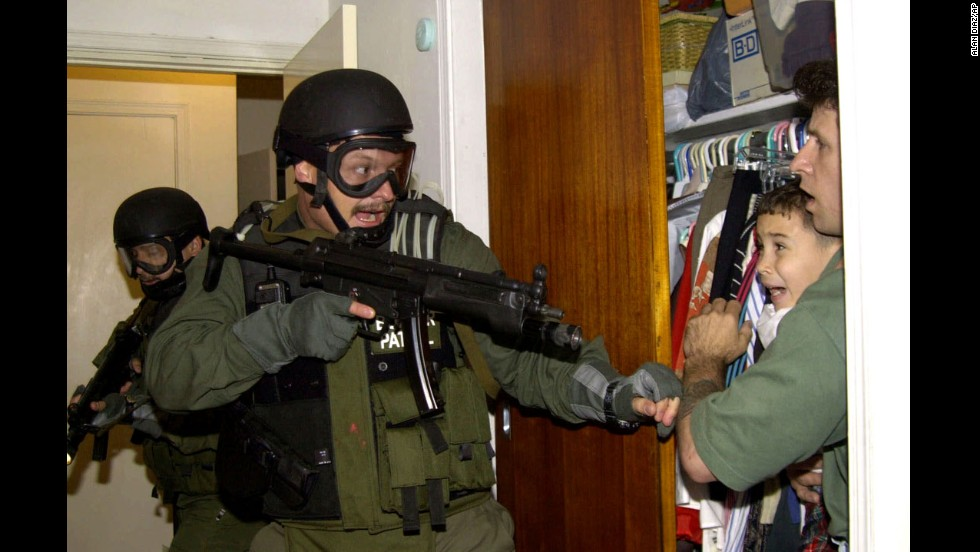 "During a raid at a Miami home in 2000, armed federal agents confront Elian Gonzalez, 6, and one of the men who helped rescue the boy. Gonzalez watched his mother drown when the boat smuggling them from Cuba capsized. Under international law, U.S. authorities were required to return the boy to his father in Cuba. Alan Diaz's photograph of the saga's defining moment won a Pulitzer Prize. ""The cry I heard that day I had never heard in my life,"" <a href=""http://articles.sun-sentinel.com/2010-04-22/news/fl-elian-photographer-20100422_1_cry-elian-gonzalez-haunted"" target=""_blank"">Diaz said a decade later</a>. ""A cry like that will haunt anyone forever."""