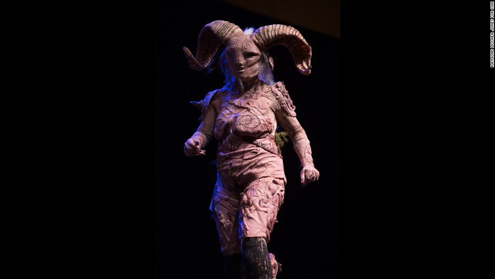 "Alyssa Smith walks on stage as Fauno from the movie ""Pan's Labyrinth."""