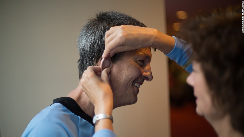 Michael Robert of Decatur, Georgia, gets help with one of his Vulcan ears from his wife, Diana. It is their second time attending Dragon Con.