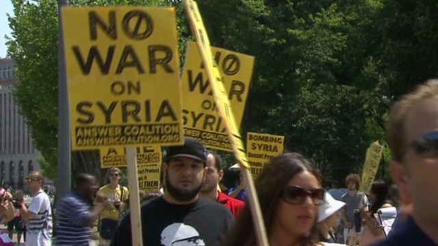 Protests outside W.H.; Obama talks Syria