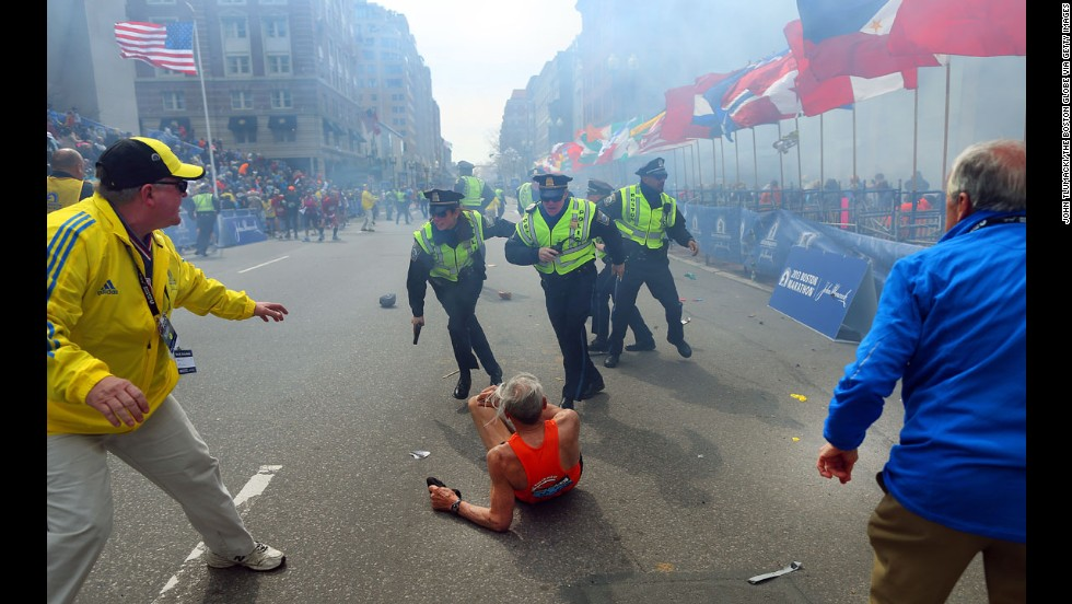"Boston Globe photographer John Tlumacki was near the finish line when 78-year-old runner <a href=""http://piersmorgan.blogs.cnn.com/2013/04/15/bill-iffrig-subject-of-iconic-boston-globe-photo-the-shock-waves-hit-my-whole-body-my-legs-just-started-jittering-around-i-knew-i-was-going-down/"">Bill Iffrig was knocked down</a> by the first explosion at the Boston Marathon on April 15. The bombings left three people dead and injured more than 100. Iffrig got up and finished the race. Tlumacki's image of the fallen runner was widely published and selected for the cover of ""Sports Illustrated."""