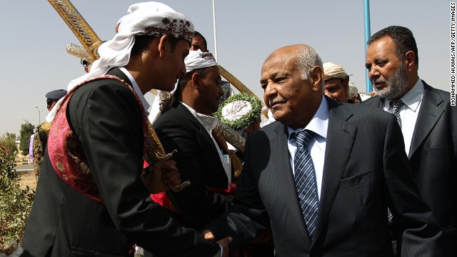 Yemeni PM Mohammed Salem Basindwa (R) at a mass wedding ceremony in Sanaa on March 14, 2013.