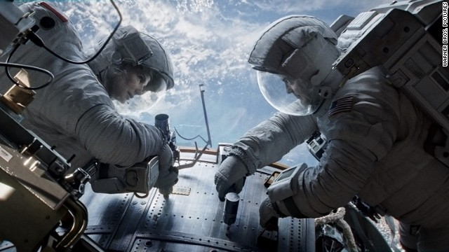 "Sandra Bullock stars as Dr. Ryan Stone and George Clooney stars as Matt Kowalsky in ""Gravity."""