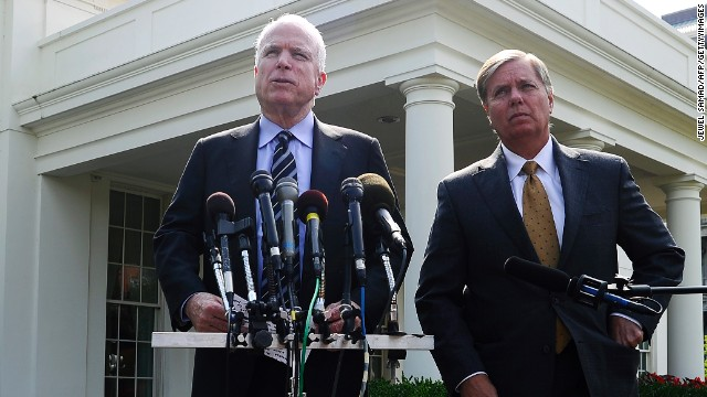 US Senator John McCain, R-AZ, answers a question as Senator Lindsey Graham, R-SC, looks on following their meeting with US President Barack Obama at the White House in Washington, DC, on September 2, 2013. McCain said Monday that Congress's failure to authorize military action in Syria would be 'catastrophic' because it would undermine US credibility. AFP Photo/Jewel Samad (Photo credit should read JEWEL SAMAD/AFP/Getty Images)
