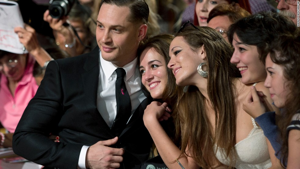 "Actor Tom Hardy poses with fans on the red carpet for the film ""Locke"" at the Venice Film Festival on September 2."