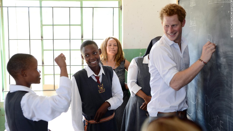 Prince Harry works with children at the Kananelo Centre for the Deaf in Maseru, Lesotho, on February 27.