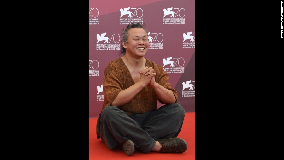 "South Korean director Kim Ki-duk poses during a photo call for ""Moebius,"" presented out of competition on September 3."