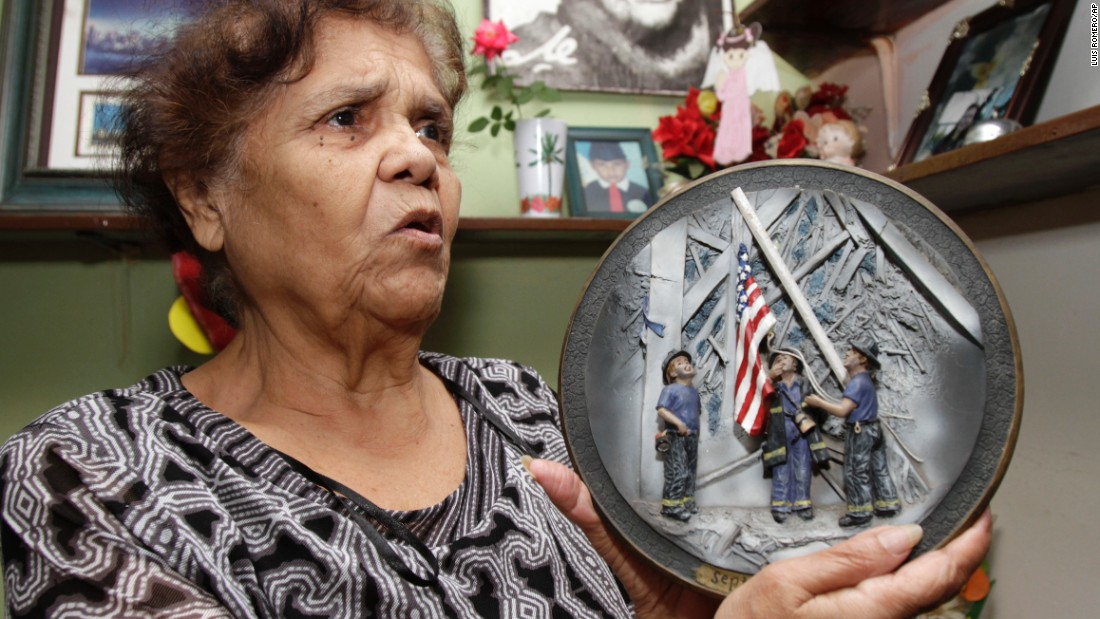 A woman holds a commemorative plate at her home in San Salvador, El Salvador, on September 7, 2011.