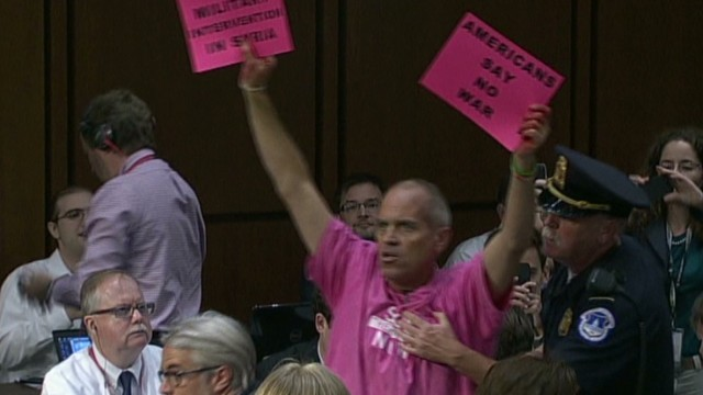 Protesters interrupt hearing on Syria
