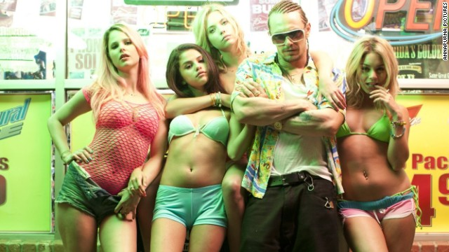 "James Franco, center, stars as a rapper/hustler/predator in the movie ""Spring Breakers."""