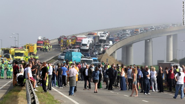 "A general view of the scene on the Sheppey Bridge Crossing near Sheerness in Kent, south England, following a multi vehicle collision earlier this morning, Thursday Sept. 5, 2013.  According to police at the scene around 100-vehicles are involved in the pile-up on a bridge in heavy fog, leaving at least eight people seriously injured after what witnesses described as ''carnage"". (AP Photo/Gareth Fuller, PA) UNITED KINGDOM OUT - NO SALES - NO ARCHIVES"