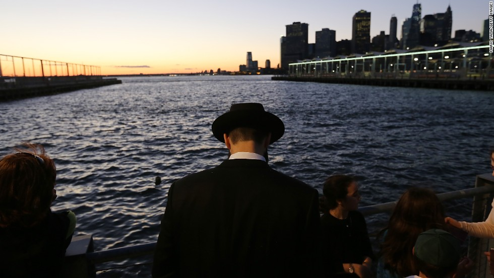 An Orthodox Jewish man marks Rosh Hashanah at Brooklyn Bridge Park during a traditional Tashlich ceremony in the Brooklyn borough of New York on Thursday, September 5. Rosh Hashanah, the Jewish New Year, started at sundown Wednesday and runs through Friday. It is a time for reflection and repentance that leads up to Yom Kippur, the day of atonement.