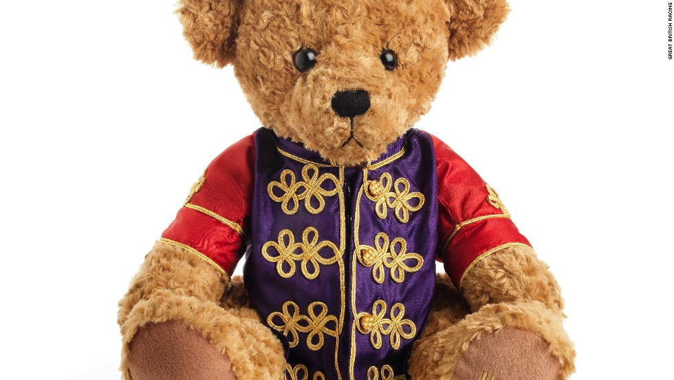 The latest addition to the British royal family, Prince George of Cambridge, was gifted a teddy dressed in the queen's silks, by a leading horse racing organization.